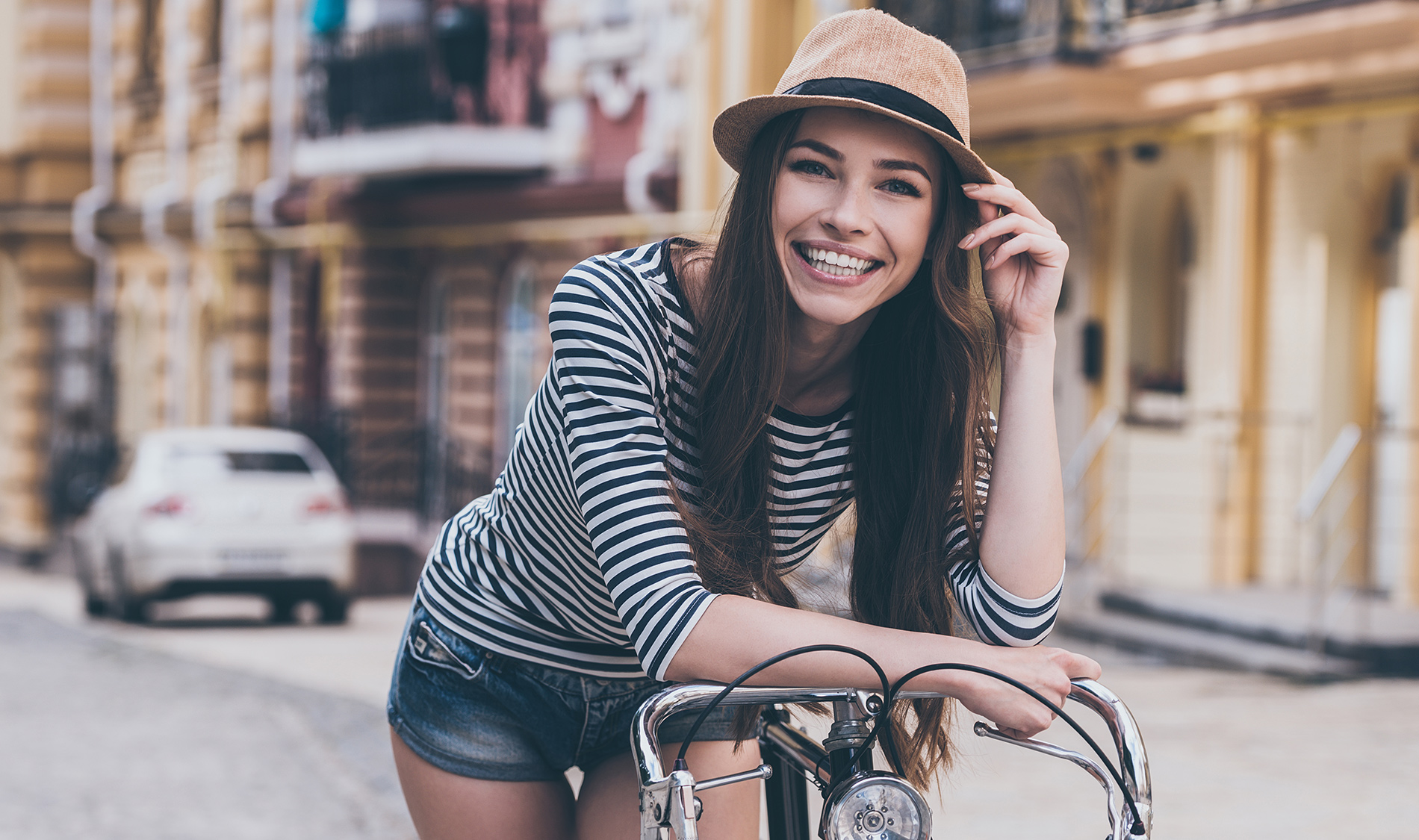 Woman smiling on bike